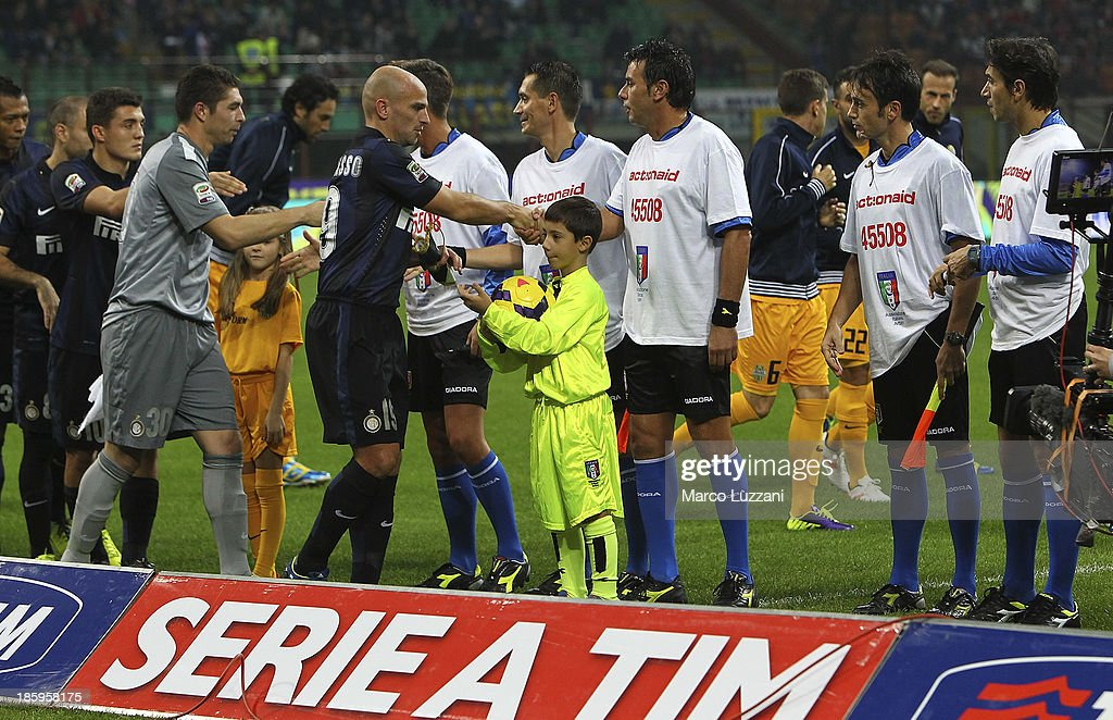 Officials and FC Internazionale Milano players support ActionAid prior to the Serie A match between FC Internazionale Milano and Hellas Verona at Stadio Giuseppe Meazza on October 26, 2013 in Milan, Italy.