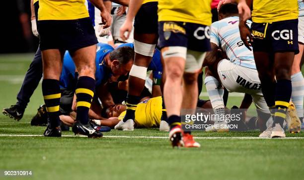 TOPSHOT Officials and medical personnel attend to the injured Clermont winger Samuel Ezeala during the France Top 14 rugby union match between Racing...