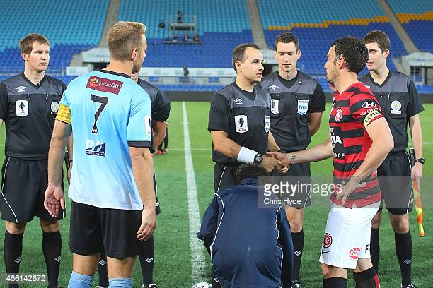 Officials and players coin toss before the start of the FFA Cup Round of 16 match between Palm Beach Sharks and Western Sydney Wanderers at Cbus...