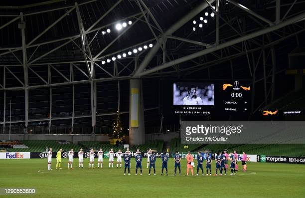 Officials and players of Dundalk and Arsenal stand for a minutes silence in memory of Paolo Rossi during the UEFA Europa League Group B stage match...