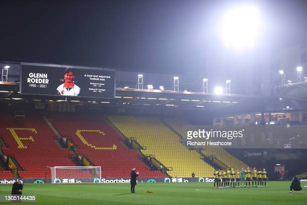 Officials and Players of Watford observe a minutes silence in memory of Glenn Roeder prior to the Sky Bet Championship match between Watford and...
