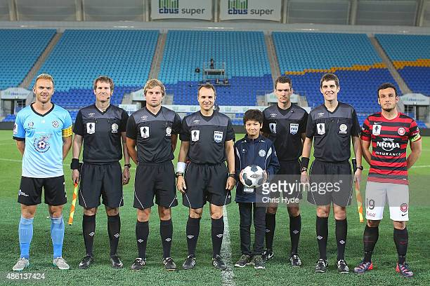 Officials and players pose before the start of the FFA Cup Round of 16 match between Palm Beach Sharks and Western Sydney Wanderers at Cbus Super...