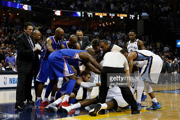Officials and players try to separate Zach Randolph of the Memphis Grizzlies and Blake Griffin of the Los Angeles Clippers during Game Six of the...