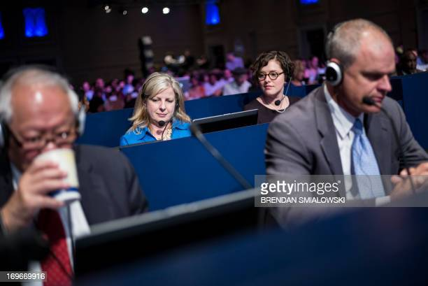 Officials and staff work during the semifinal round at the Scripps National Spelling Bee on May 30 2013 in National Harbor Maryland Fortyone...