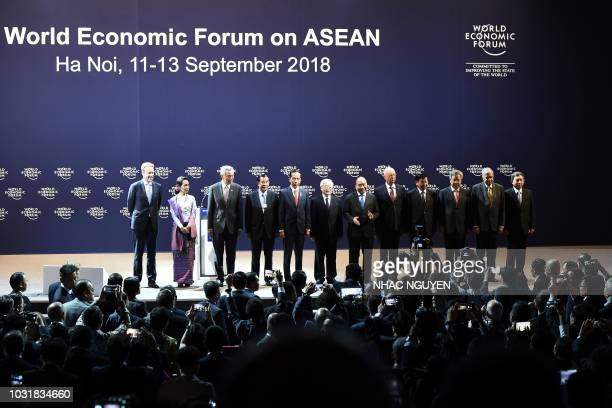 Officials and state leaders from left President of World Economic Forum Borge Brende Myanmar State Counsellor Aung San Suu Kyi Singapore Prime...