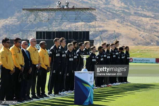 Officials and the New Zealand team line up for the national anthems during the ICC U19 Cricket World Cup match between New Zealand and England at...