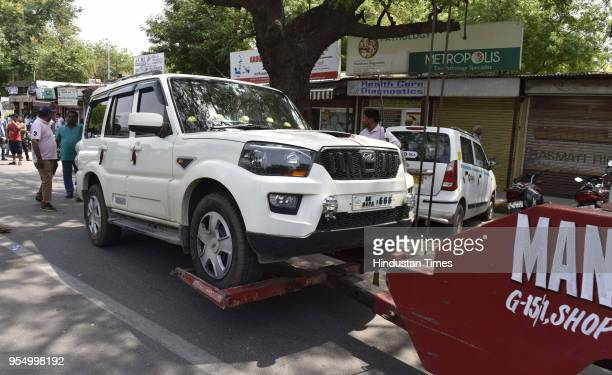 MCD officials and Traffic Police conduct a drive to lift vehicles from no parking areas at Yusuf Sarai on May 5 2018 in New Delhi India