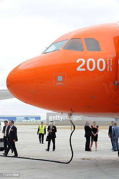 Officials and workers arrive to attend on May 26 the ceremony which marks the delivery to the lowcost airline EasyJet of an Airbus A320 the 200th...