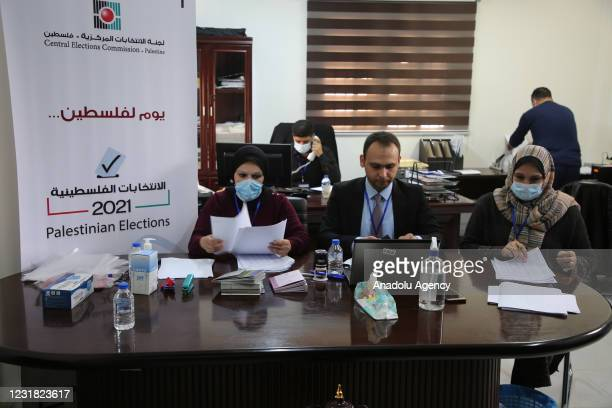 Officials are seen at Central Election Commission building after Palestinian authorities on Saturday opened registration for the legislative...