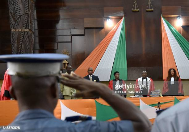 Officials arrive at the courthouse in Abidjan as the trial of Ivory Coast's former first lady Simone Gbagbo for crimes against humanity resumes on...