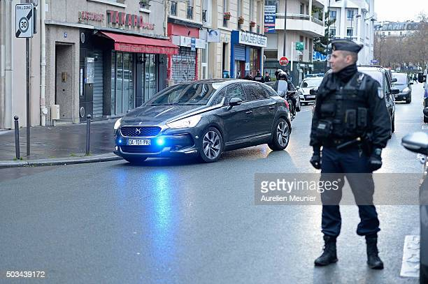 Officials arrive to the inauguration of the memorial stone in front of the former Charlie Hebdo office on January 5 2016 in Paris France One year...