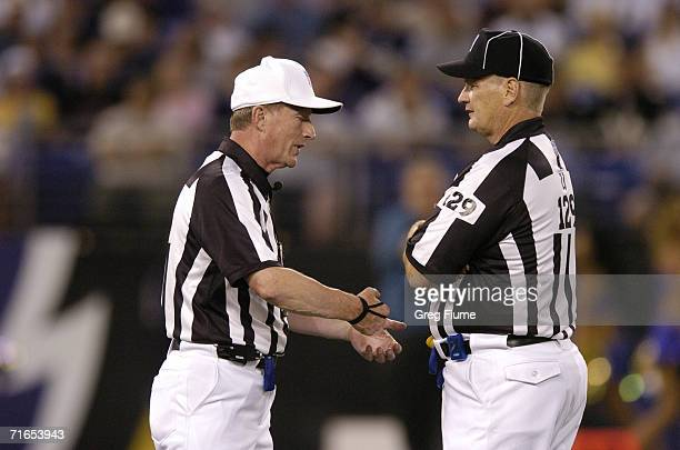 Officials Bill Carollo and Eddie Powers speak as the Baltimore Ravens play against the New York Giants on August 11 2006 at MT Bank Stadium in...