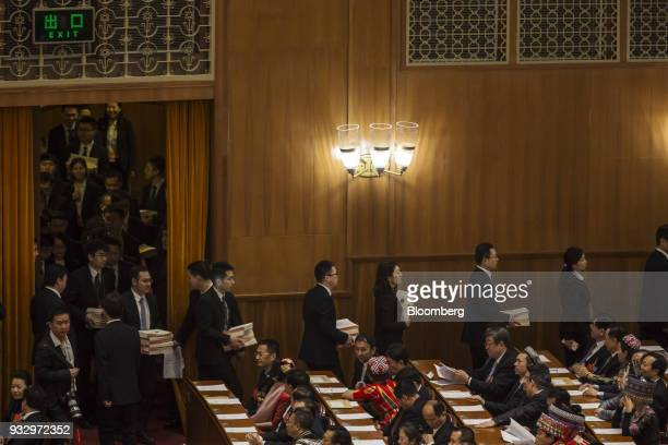 Officials carry ballots during a session at the first session of the 13th National People's Congress at the Great Hall of the People in Beijing China...