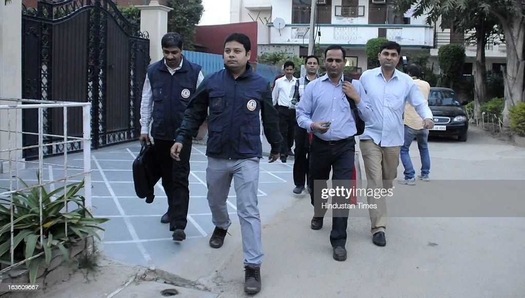 CBI Officials carry documents and laptop as they leave after conducting a raid at the residence of former air chief marshal S P tyagi in in Sector 23A near Palam Vihar on March 13, 2013 in Gurgaon, India. After registering a case against Tyagi and 12 others in connection with India's $750-million AgustaWestland chopper deal with Italian company Finmeccanica CBI conducted raids at 14 locations including his residence.