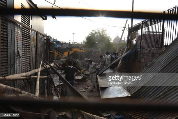 MCD officials carry out an antiencroachment drive near Jama Masjid on May 3 2018 in New Delhi India A Special Task Force formed to enforce an apex...