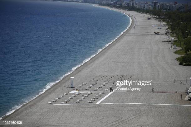 Officials carry out cleaning works at Konyaalti Beach for tourists within measures taken against coronavirus pandemic in Antalya Turkey on May 27 2020