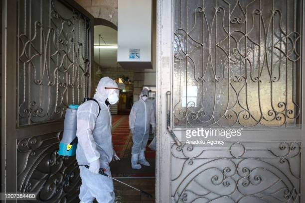Officials carry out disinfection works as a precaution against the coronavirus continue at Ali ibn Abi Talib Mosque in Jerusalem on March 16, 2020.