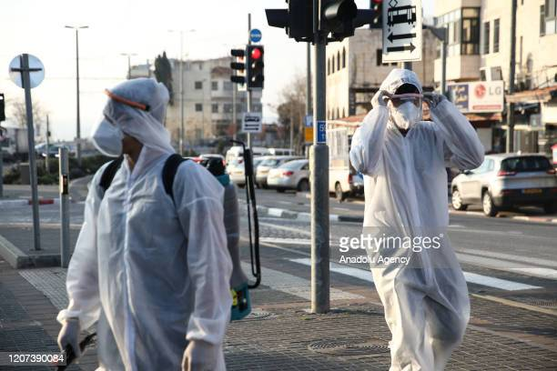 Officials carry out disinfection works as a precaution against the coronavirus at a tram station in Shuafat district in Jerusalem on March 16, 2020.
