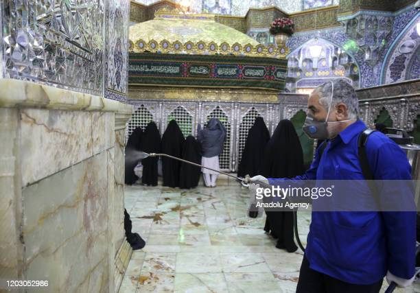 Officials carry out disinfection works as restrictions have been placed on religious ceremonies at Fatima Masumeh Shrine to prevent spreading...