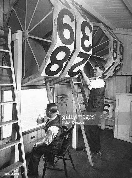 Officials change the score inside the score box during the England versus South Africa cricket test match at Nottingham in 1935