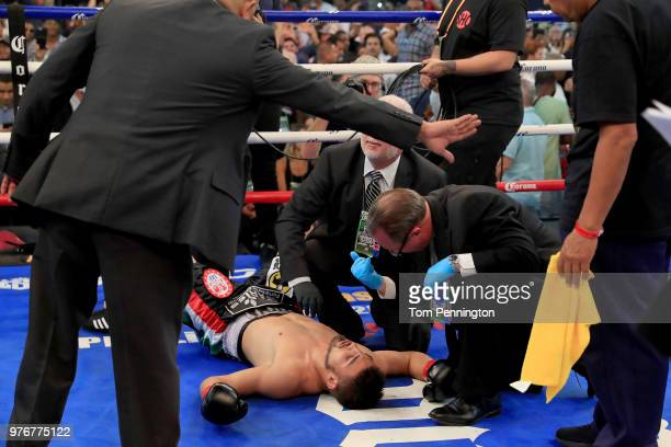 Officials check on Carlos Ocampo after he was knocked out by Errol Spence Jr in the first round of a IBF Welterweight Championship bout at The Ford...
