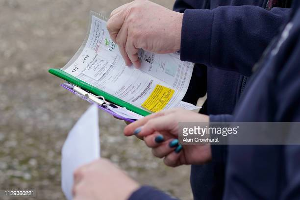 BHA officials check the passport of a runner as it arrives at the track due to Equine Influenza there has been no racing for six days at Plumpton...