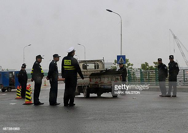Officials check vehicles leading to the town of Oubei outside the city of Wenzhou on April 30 where Chinese authorities began demolishing a Christian...