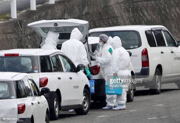 Officials clad in protective wear prepare to conduct further tests on Jan 11 at a poultry farm in Sanuki in southwestern Japan's Kagawa Prefecture...