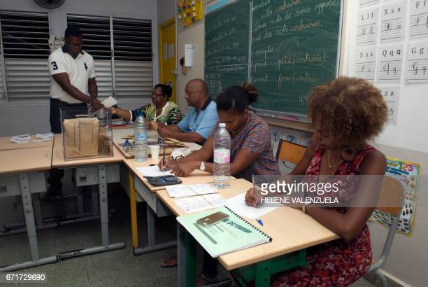 Officials count ballots at a polling station in Gosier on the French Caribbean island of Guadeloupe on April 22 during the first round of the...