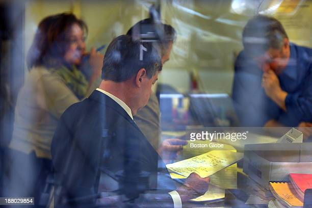Officials count provisional ballots in the Lawrence Election Department office in the basement of City Hall The winner of the Lawrence mayoral race...