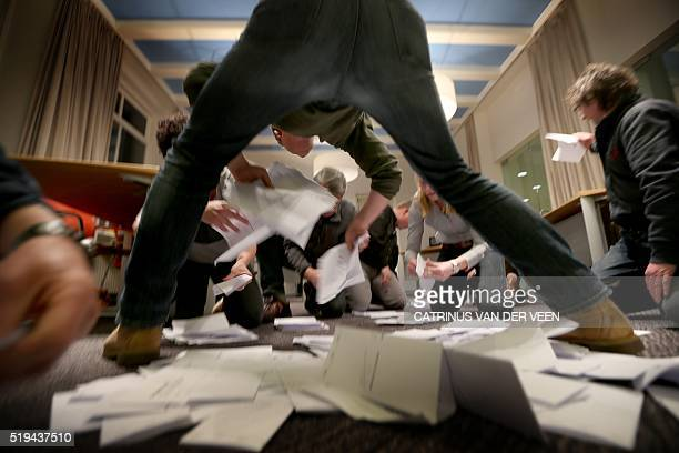 Officials count the votes of the Dutch referendum about the association agreement between the EU and Ukraine on April 6 2016 at a voting office in...