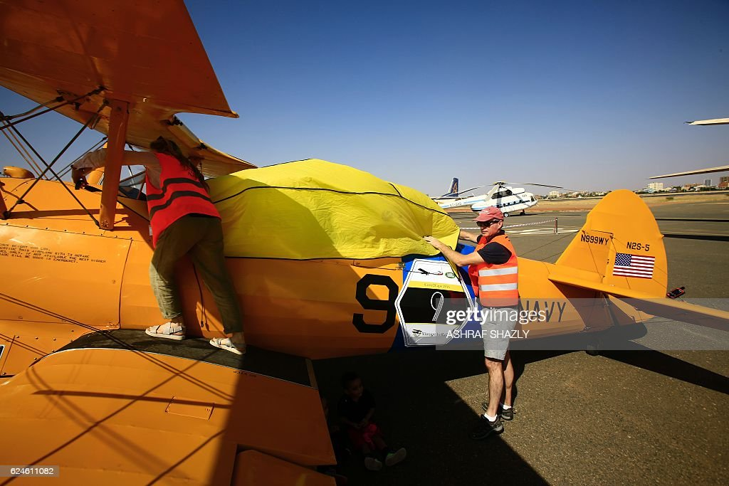 Officials cover the vintage Boeing-Stearman Model 75 biplane