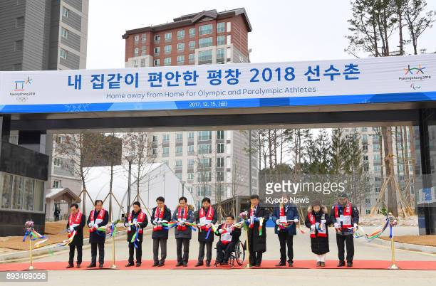Officials cut the tape at a ceremony in Pyeongchang South Korea on Dec 15 as an athletes' village is completed for the 2018 Winter Olympics ==Kyodo