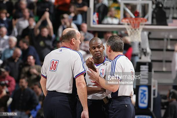 NBA officials David Jones Sean Wright and Joe DeRosa confer on a call during a game between the San Antonio Spurs and the Utah Jazz at the Energy...