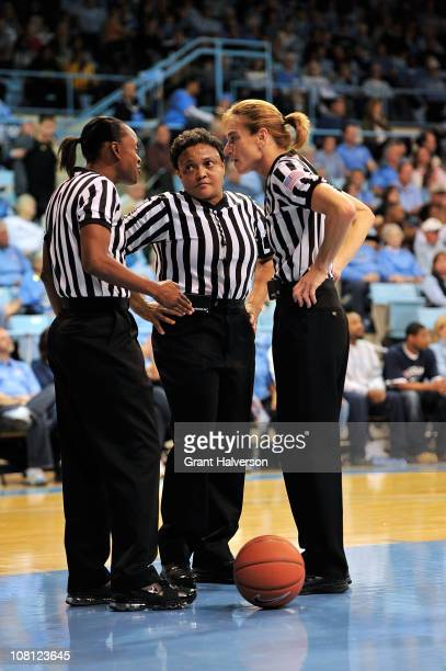 Officials Dee Kantner Denise Brooks and Bonita Spence huddle during a game between the Connecticut Huskies and the North Carolina Tar Heels at...