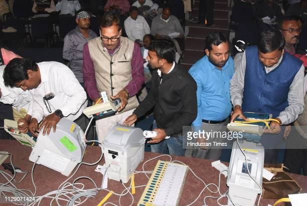 Officials demonstrate the functioning of Electronic Voting Machine and Voter Verified Paper Audit Trail during a training programme at Hindi Bhawan...