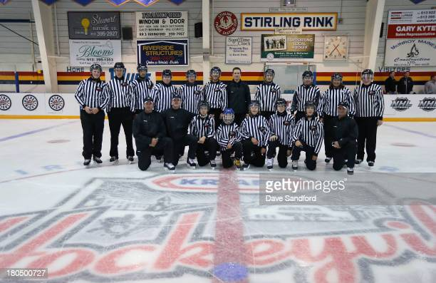 NHL officials Derek Nansen Kevin Pollock Steve Barton and Greg Kimmerly pose for a photo with local minor league officials during the NHL Officials...