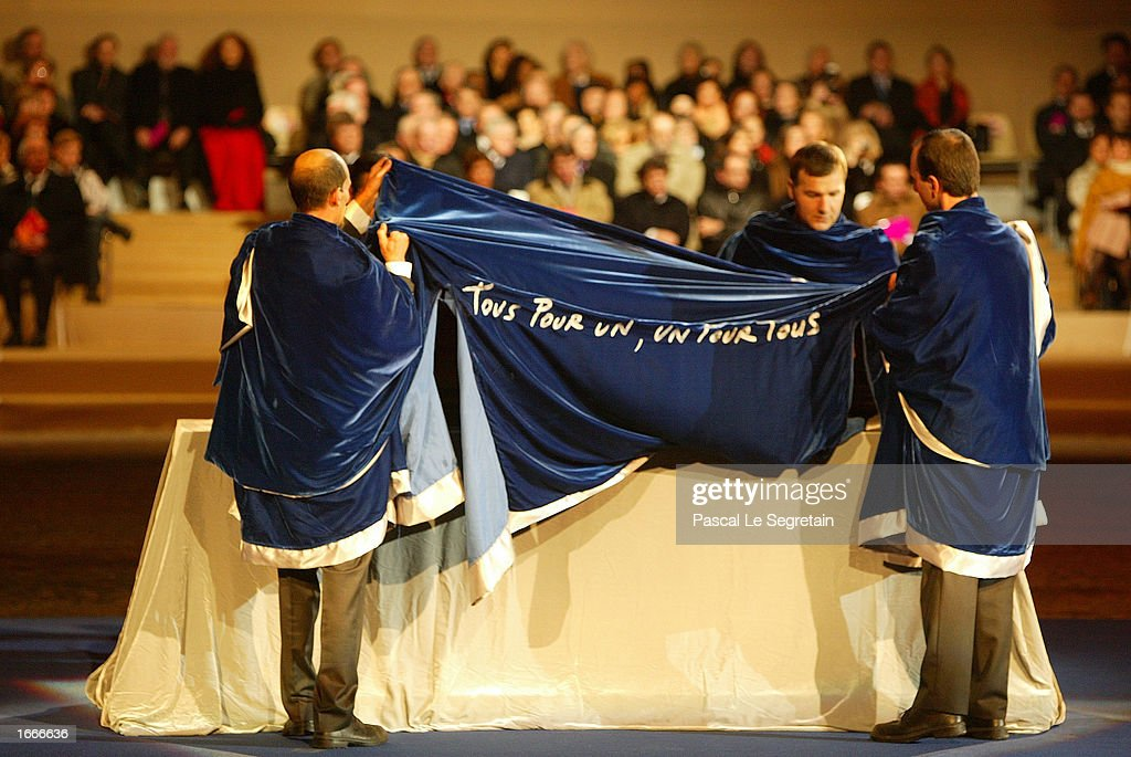 Officials dressed as musketeers remove a covering from the coffin of author Alexandre Dumas November 30, 2002 in Paris, France during a ceremony to transfer Dumas' ashes to the Pantheon. The Pantheon is the traditional resting place of the remains of France's greatest historical and cultural figures.