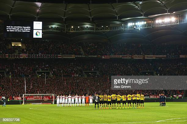 Officials fans and players observe a minutes silence to remember those who lost their lives in today's rail accident in Bavaria prior to the DFB Cup...