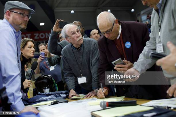 Officials from the 68th caucus precinct overlook the results of the first referendum count during a caucus event on February 3 2020 at Drake...
