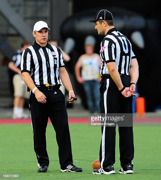 Officials from the Big East Conference stand on the field while discussing a call during a game between the Cincinnati Bearcats and Delaware State...