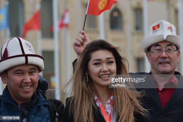 Officials from the delegation of Kyrgyzstan with their national flag during Athletes Village Welcome Ceremony of Baku 2017 4th Islamic Solidarity...