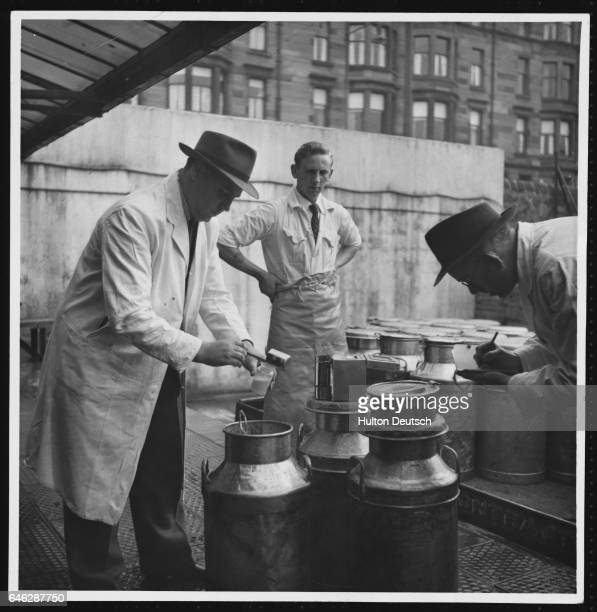 Officials from the Glasgow Council's Department of Health take samples from milk churns for analysis
