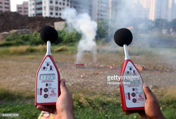 Officials from the Maharashtra Pollution Control Board and NGO Awaaz Foundation conduct readings of the noise decibels as a result of bursting...