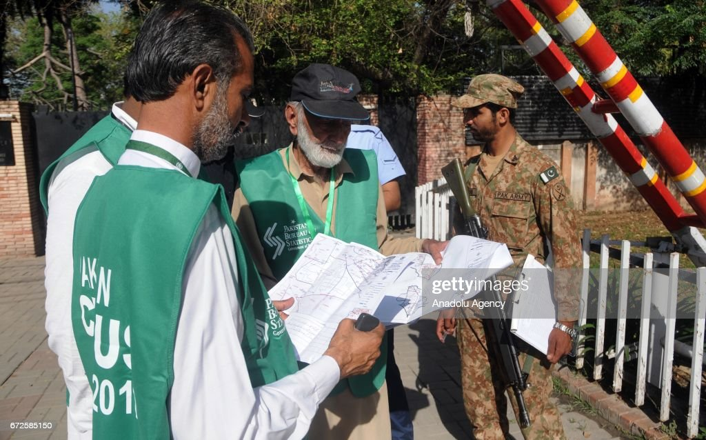 Officials from the Pakistan Bureau of Statistics check a map before conducting door to door census during the second phase of sixth population census.