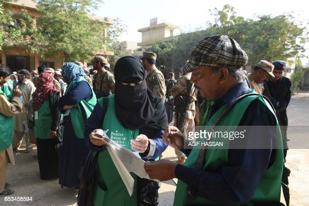 Officials from the Pakistan Bureau of Statistics prepare to leave for a residential area for a census in Karachi on March 15 2017 Pakistan on March...