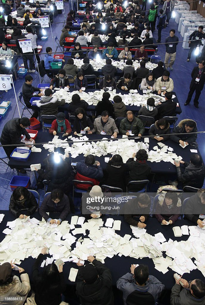 Officials from the South Korean Central Election Management Committee count votes cast during the Presidential election at the Yuido High School on December 19, 2012 in Seoul, South Korea. Ruling Seanuri Party candidate Park Geun-Hye and opposition Democratic United Party candidate Moon Jae-In have been locked in a close race with each other during the election campaign.