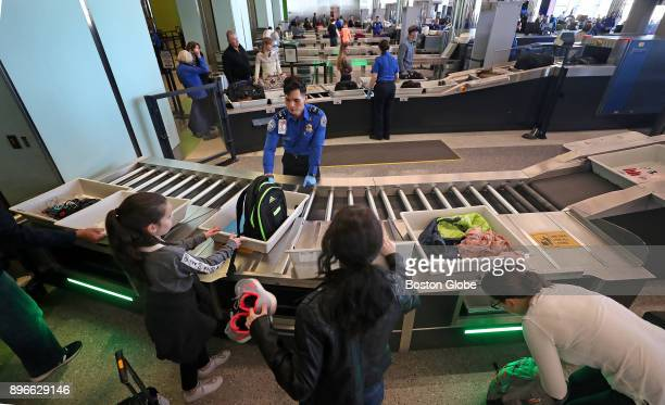 Officials from the Transportation Security Administration and Massachusetts Port Authority introduce the new automated screening lanes at Logan...