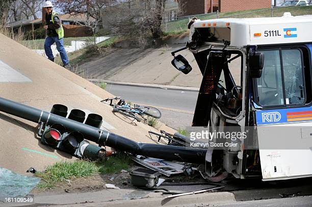 Officials from various agencies investigate an accident involving an RTD bus that was hit by a car that ran a red light near West Sixth Avenue and...
