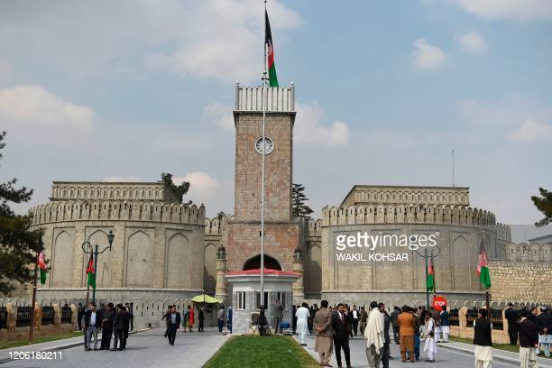 Officials gather at an entrance ahead of the start of Afghanistan President Ashraf Ghani's swearingin inauguration ceremony at the Presidential...